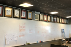 Caricatures in IT room, Colorado Spring office