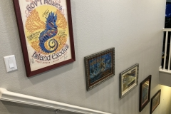 rock posters in stairway Commerce City